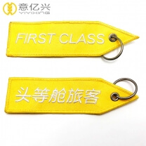 Personalized yellow embroidered flight keychain with name tag
