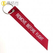Best selling cheap woven remove before flight jacket tag