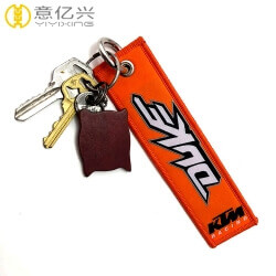 Wholesale custom luggage label remove before flight key keychain