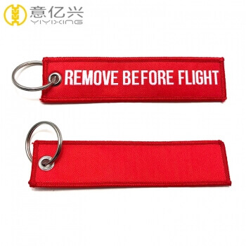 Beautiful polyester printed woven remove before flight ribbon keychain