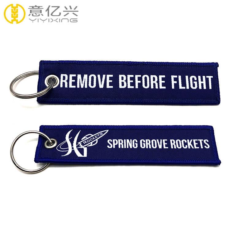 Custom both sides logo machine woven remove before flight key tag