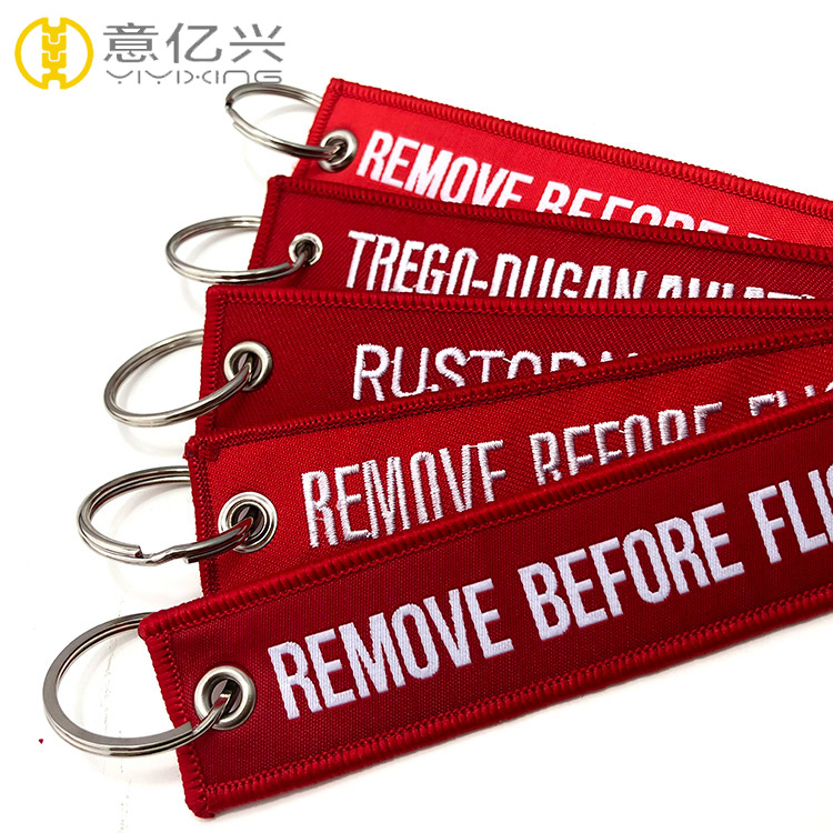 cloth remove before flight streamer keychain