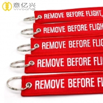 Wholesale cheap cloth remove before flight streamer keychain