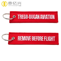 Wholesale fabric customized remove before flight tag keychains