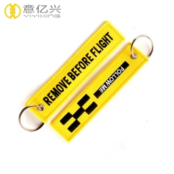 Popular style custom yellow embroidered remove before flight keyrings