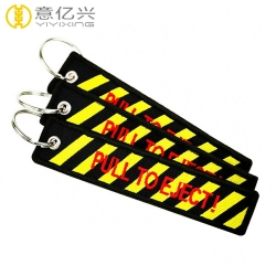 Hot sell quality fabric embroidery pull to eject keychain