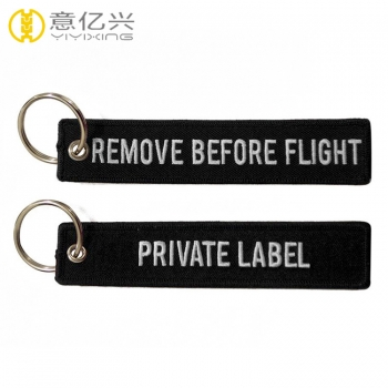 Hot sale customized remove before flight keychain wholesale