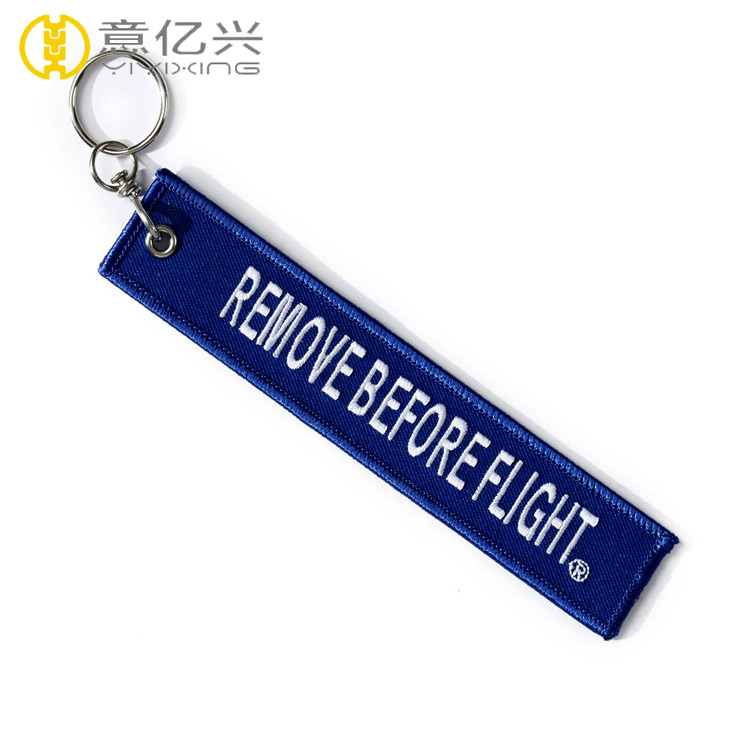 embroidered remove before flight keychain