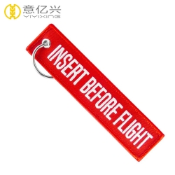 Custom embroidery logo label red insert before flight keychain