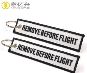 OEM stylish printing white tape remove before flight keychain design
