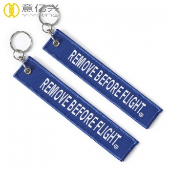 personalized remove before flight keychain