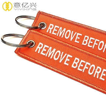 Fashionable double side customized remove before launch keychains