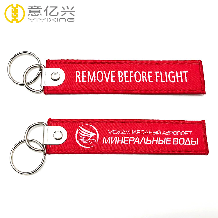 Custom fabric airplane keychain with remove before flight ribbon