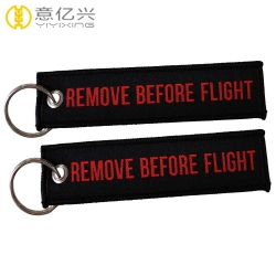 Double side logo woven remove before flight keychain custom