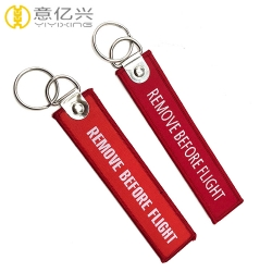 Custom woven fabric keychain remove before flight tags for sale