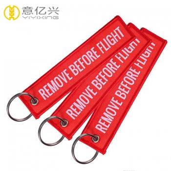 Free sample top quality customized woven remove before flight tag keychain
