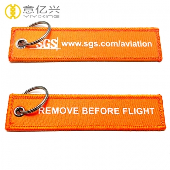 woven remove before flight key chain
