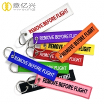 promotional fabric or polyester woven remove before flight key chain