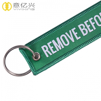 High quality free samples custom woven take off before flight keychain