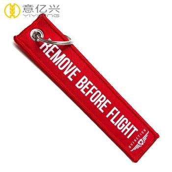 remove before flight woven keyring