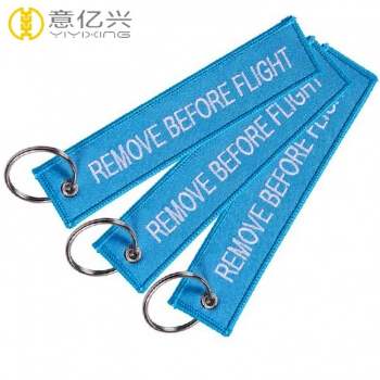 remove before flight keychain blue